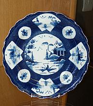 A Bow blue and white chinoiserie plate,