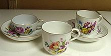 Two Meissen cups and saucers together with a Berlin cup,