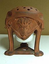 An early 19th century redware pot pourri vase and cover, together with a later porcelain liner,