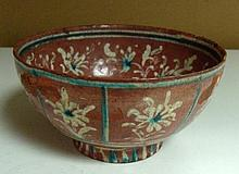 A terracotta ground bowl, possibly 18th century Kutahya,