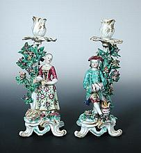 A pair of Bow figural candlesticks,