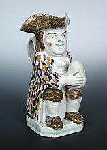 A late 18th/early 19th century Prattware Toby jug,