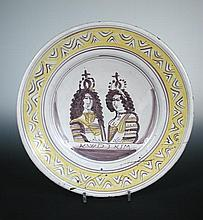 A late 17th century Delft coronation dish for King William and Queen Mary,