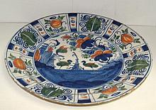 A mid 18th century Dutch Delft polychrome dish
