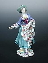 An 18th century Meissen figure of a lady,
