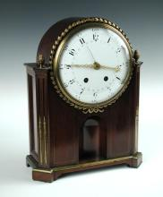 A mahogany cased mantle clock in the Directoire style,