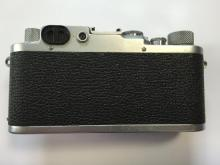 A leather cased 1951 Leica IIIF camera with Elmar f=5 1:3.5 'm' fit lens,