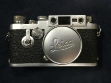A leather cased 1957 Leica III G camera with Summicron chrome f=5 1:2 lens,