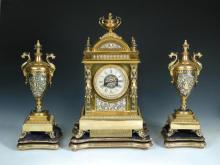 A French 19th century gilt and decorated clock garniture,