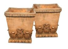 A pair of trellis moulded coloured composite stone square urns,