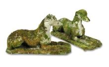 A pair of reconstituted stone greyhounds,