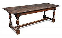 A Jacobean style oak refectory table, 20th century