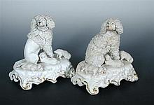 Two similar early Victorian Staffordshire poodle and puppy groups,