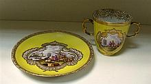 An 18th century Meissen yellow ground chocolate cup and saucer