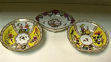 Two Meissen saucers and a spoon tray,