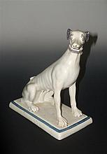 An 18th century French faience hound,