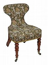 A 19th century mahogany framed conversation chair, circa 1905