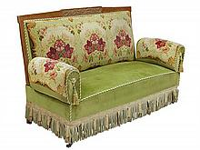 A late 19th century Continental oak framed upholstered day bed, circa 1890