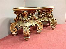 A pair of giltwood urn stands, 19th century