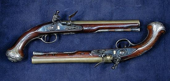 A pair of 18 bore silver mounted flintlock holster pistols by Henry Hadley, London, hallmarked for 1757,