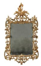 An 18th century carved giltwood framed wall mirror,