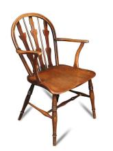An early 19th century ash and fruitwood Windsor armchair,