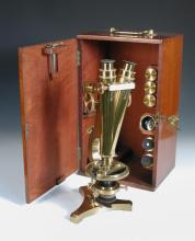 A good 19th century lacquered brass binocular microscope by R. & J. Beck, No. 19432,