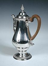 A George III silver coffee pot,