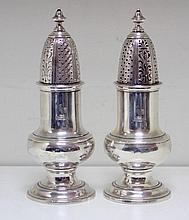 A pair of mid 18th century provincial silver casters,