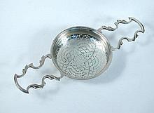A George II silver lemon strainer,