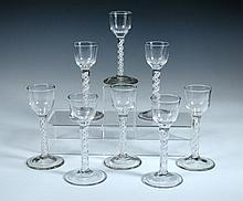 A set of eight 18th century opaque twist glasses,