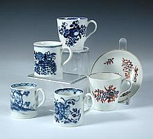 Four 18th century Worcester blue and white coffee cans and another with saucer,