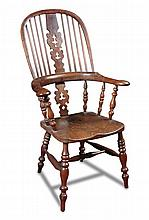 A 19th century yew wood Windsor armchair,