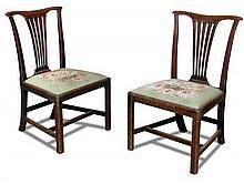 A pair of George III mahogany dining chairs,