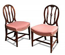 A pair of mahogany dining chairs, 18th century