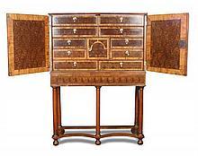 A Queen Anne style laburnum oyster veneer cabinet, 19th century