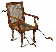 A 19th century Satin birch patent invalid chair,