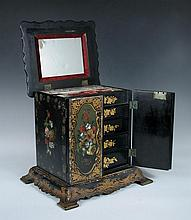 An early Victorian papier maché jewellery cabinet,