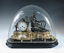 A late 19th century French gilt metal mounted mantel clock with glass dome,