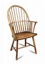 An 18th century ash and elm stick back armchair,