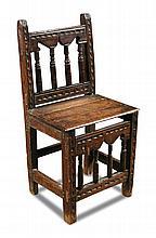 A 17th century oak child's chair,