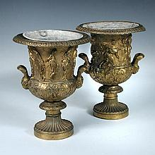 A pair of 19th century gilt bronze urns and zinc liners,