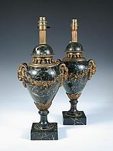 A pair of gilt metal mounted marble table lamps,