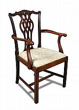 A George III mahogany elbow dining chair,