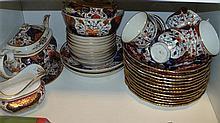 A 19th century Crown Derby Imari palette part tea service and twelve plates,