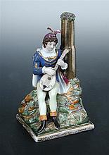 A mid 19th century Popov porcelain figure of a Renaissance lutanist,