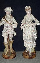 A pair of late 19th century German bisque figures, possibly Sitzendorf or Plaue on Havel,