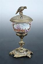 Attributed to 18th century Meissen, a tea bowl raised on ormolu stand and with cover,