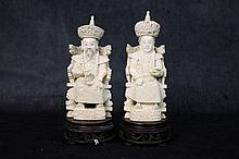 A fine pair of Chinese ivory figures depicting the noble lad