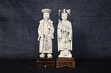 A superbly carved pair of Chinese ivory figures depicting th